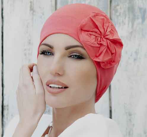 Woman wearing Chemo hat in coral
