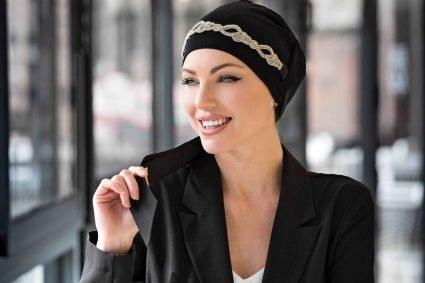 woman wearing jewelled black chemo cap