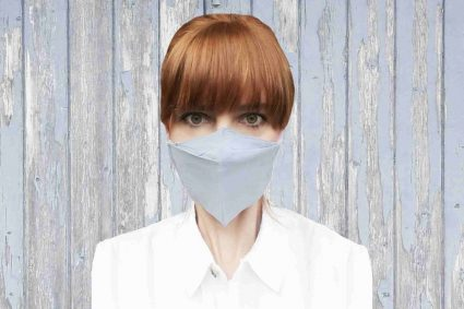 woman wearing white face nose mask