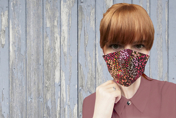 woman wearing red floral face mask
