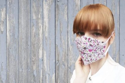 woman wearing white floral face mask