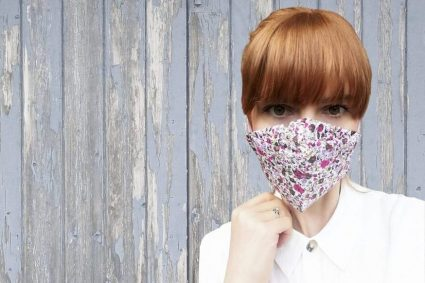 woman wearing floral mouth and nose mask