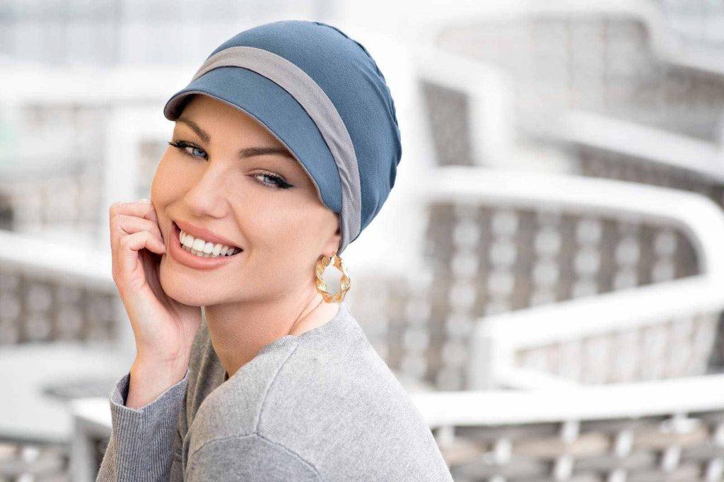 woman wearing reversible cap blue grey