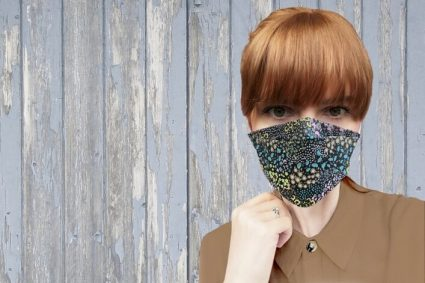 woman wearing floral pattern face mask