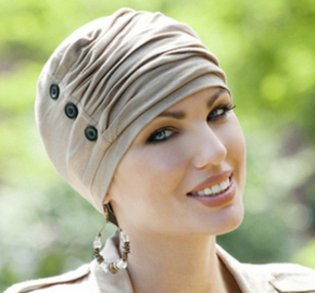 woman wearing buttoned chemo cap