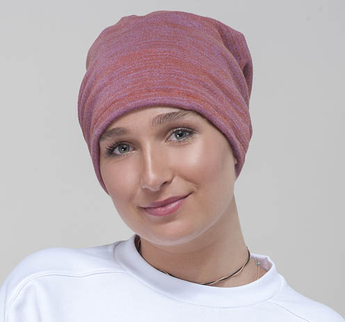 girl wearing rose colored chemo beanie