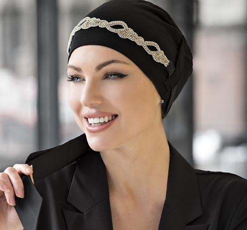 woman wearing black jewelled chemo cap