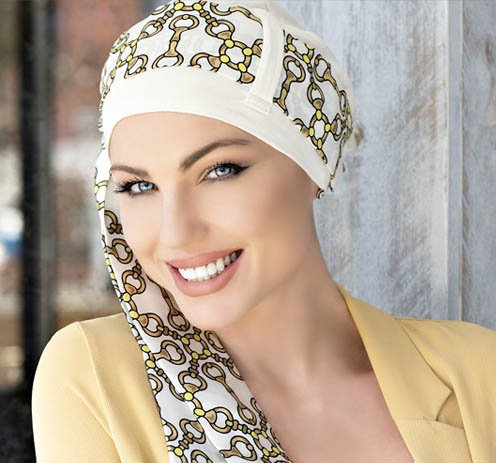 woman wearing white chemo hat golden chain