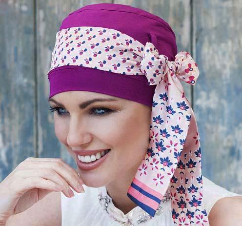 Woman wearing purple chemotherapy headwear