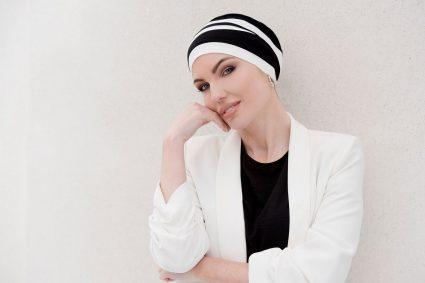 woman wearing dorna chemo cap black and white