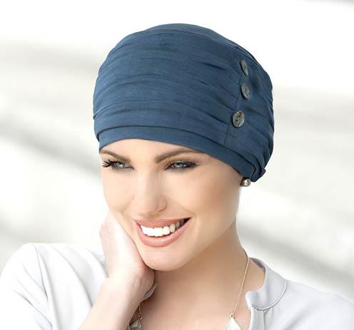 Woman wearing metallic grey chemo hat